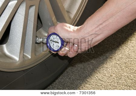 Woman Checking Tires