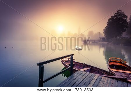 Majestic colorful scenery on the foggy lake in Triglav national park, located in the Bohinj Valley of the Julian Alps. Dramatic view. Instagram effect, retro filter. Slovenia, Europe. Beauty world.