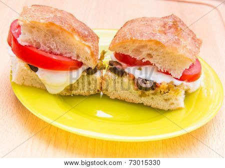 Vegetarian Hot Sandwiches With Pickle Muffaletta, Tomatoes And Melted Mozzarella Cheese. =