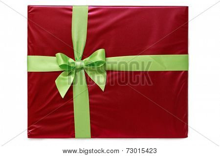 Green ribbon and bow on red gift paper