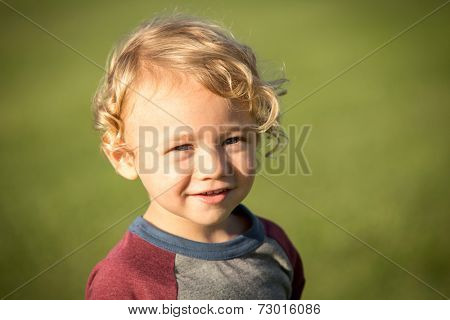 Cute little boy playing in the grass