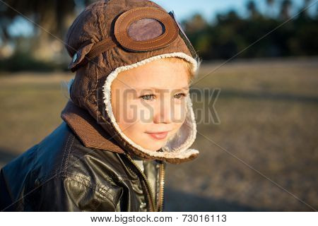 Cute little boy pilot wearing aviator hat and jacket