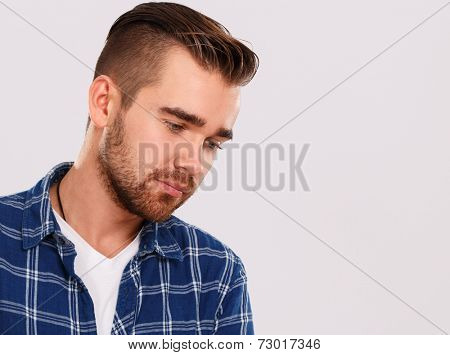 Emotions, feelings. Young guy with on a white background