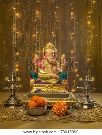 A Ganesha idol in elaborate Indian pooja set up and decoration