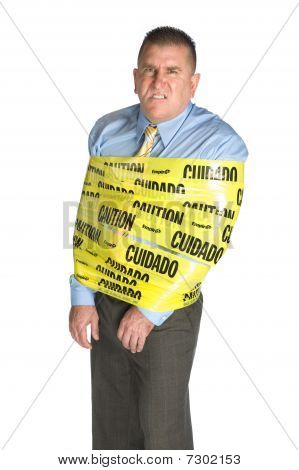 Angry Businessman Wrapped In Caution Tape