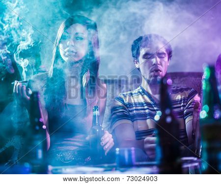 teens smoking marijuana in smoke filled room