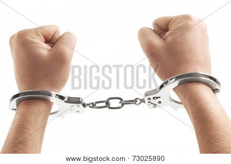 Close-up of a person handcuffed over white background