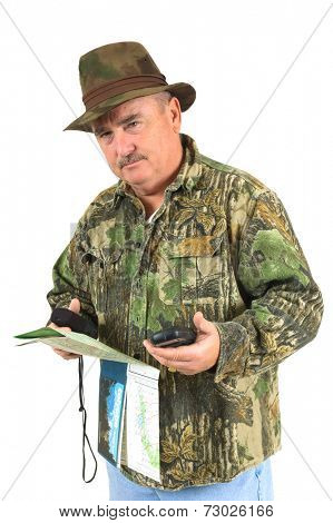 Hunter studying maps and holding a GPS to determine his whereabouts