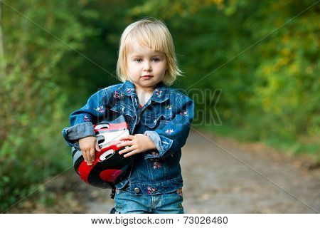 Beautiful little girl with sport helmet for bicycle, roller or skate