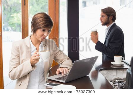 Pretty businesswoman working on her break at the coffee shop