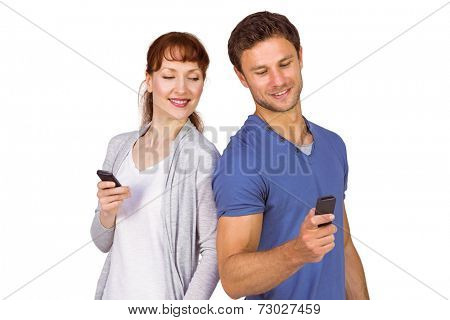 Couple both making phone calls on their mobile phones