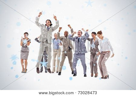 Very enthusiast business people jumping and raising their arms against snow falling