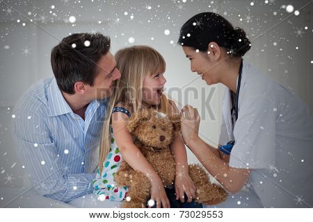 Composite image of female doctor checking her patients throat against snow