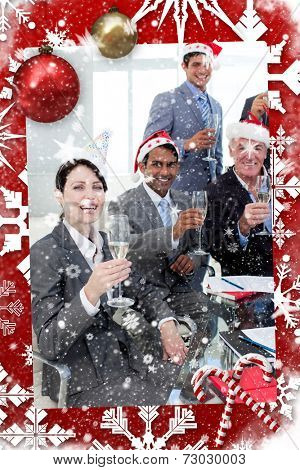Manager and his team with novelty Christmas hat toasting at a party against snow falling