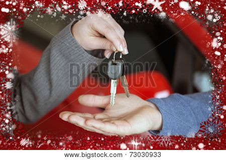 Composite image of person handing keys to someone else against snow