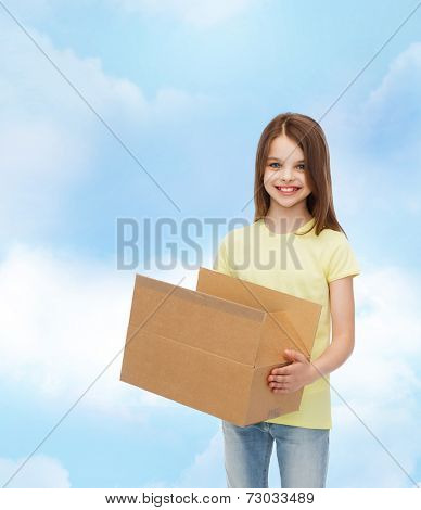 advertising, childhood, delivery, mail and people - smiling little girl holding open cardboard box over cloudy background