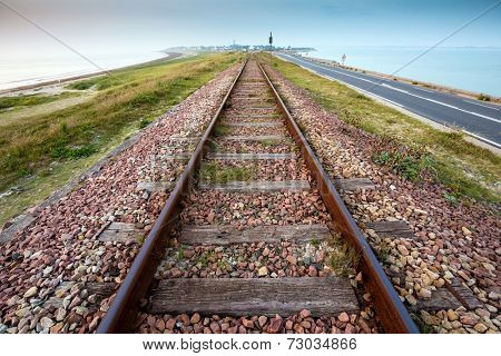 Straight railway perspective at dusk, in the Quiberon peninsula, Brittany, France