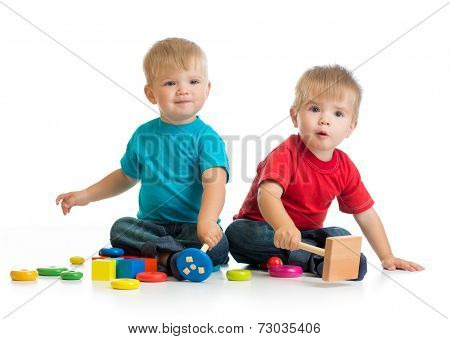 Happy children playing by mallet or hammer