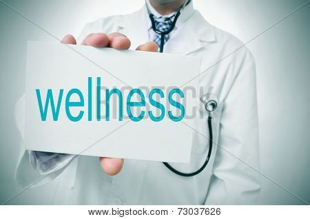 a doctor showing a signboard with the word wellness written in it