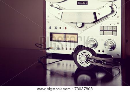 Headphones with Analog Stereo Open Reel Tape Deck Recorder Vintage Detailed Closeup