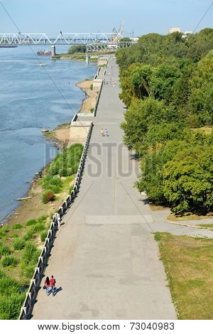 NOVOSIBIRSK, RUSSIA - AUGUST 24, 2014: People walking on the embankment of Ob river in the park