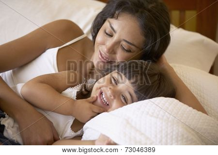 Mother and daughter giggling together