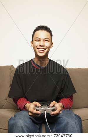 Portrait of teenage boy with game controller
