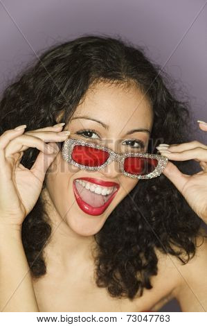 Portrait of woman with red sunglasses