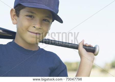Portrait of boy with baseball bat