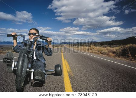 Young boy on toy motorcycle