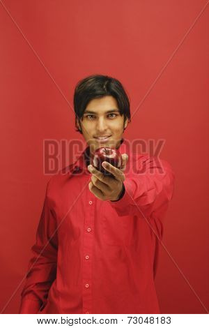 Portrait of man holding apple