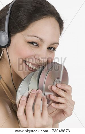 Portrait of women with headset and CD's