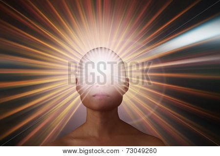 Bald young woman exuding light