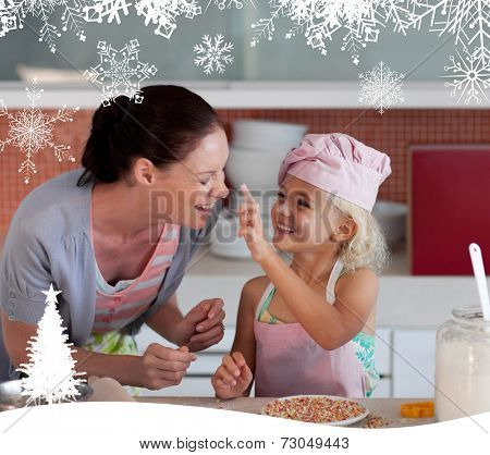 Potrait of mother and daugther having fun together against fir tree forest and snowflakes