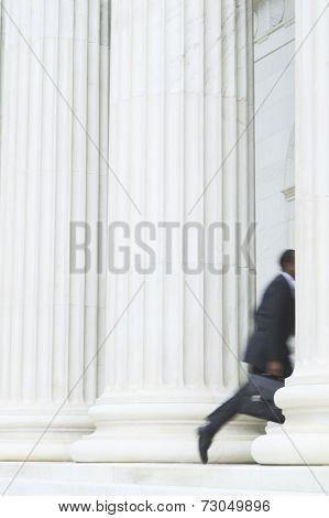 Blurred image of businessman running