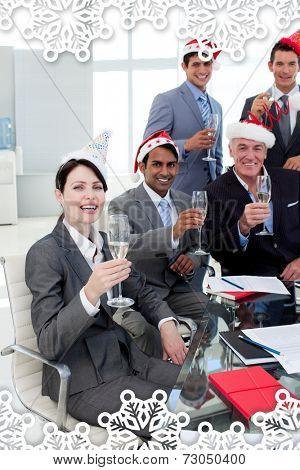 Manager and his team with novelty Christmas hat toasting at a party against snowflake frame