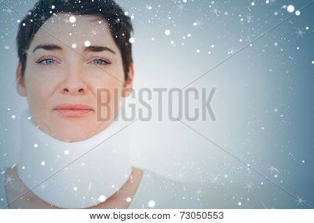 Close up of a sad Woman with a surgical collar against snow