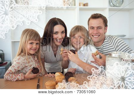 Cute children eating muffins with their parents against snowflake frame