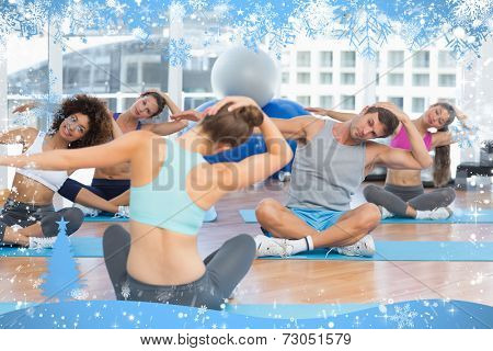 People with trainer doing pilate exercises in a bright gymYoung people with trainer doing pilate exe against snow
