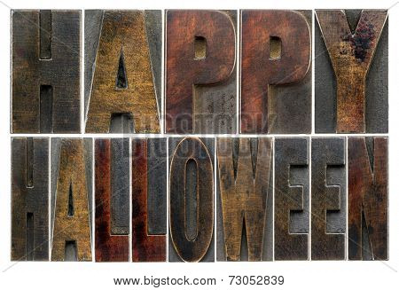 Happy Halloween  -  isolated text in vintage grunge wood type printing blocks stained by color inks
