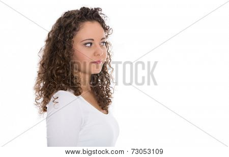 Isolated young woman with natural curls looking sideways to text.
