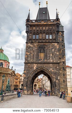 PRAGUE, CZECH REPUBLIC - 21 JUNE 2014: People walking on the Charles Bridge in Prague, Czech Republic.Charles Bridge is a famous historical bridge that crosses the Vltava river.