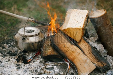 Making tea or coffee in the campfire on nature