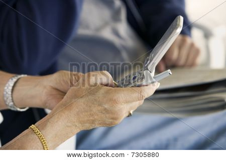 Senior woman using mobile cell phone