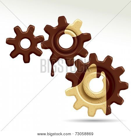 Three confectionery gears of different sizes.