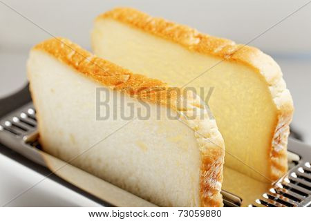 Toaster with bread slices close up photo
