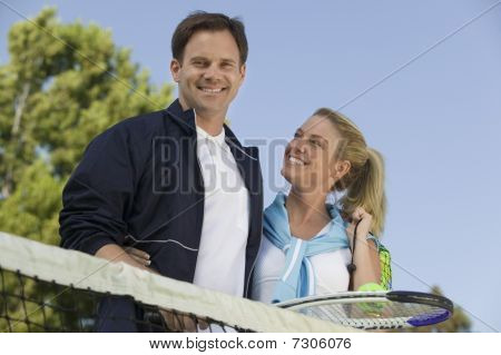 Couple at Tennis Net portrait low angle view