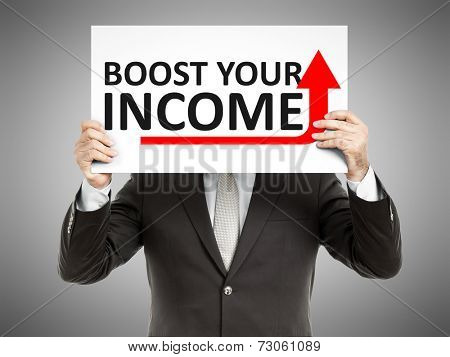 A business man holding a paper in front of his face with the text boost your income