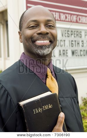 Smiling Preacher in Front of Church portrait