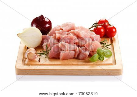 Raw tourkey meat on cutting board on white background